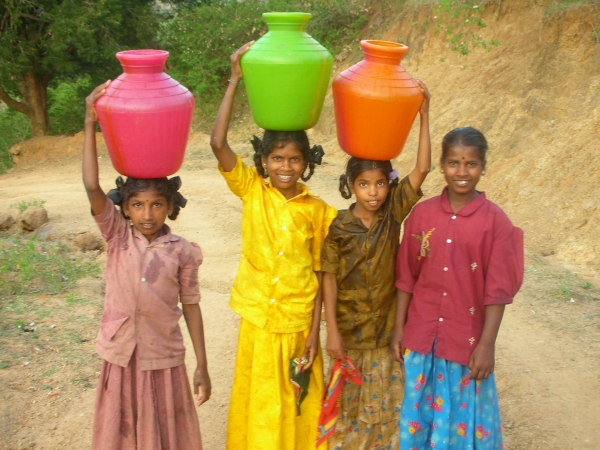 girls carring water in India